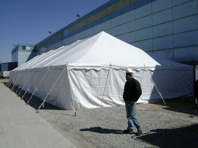 Pole tent with solid sides