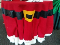 Where to rent .TABLECOVER, 96 IN. ROUND SANTA in Kokomo IN